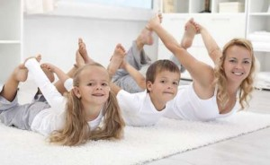 Family doing stretching exercises laying on the floor - healthy lifestyle